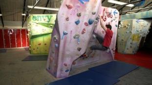 Climber on a climbing wall.