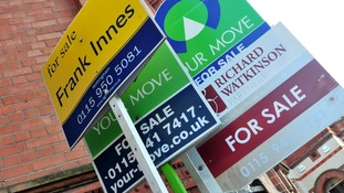 General view of for sale signs outside a block of flats.