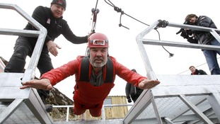 Robert Davies begins his attempt on the zip wire