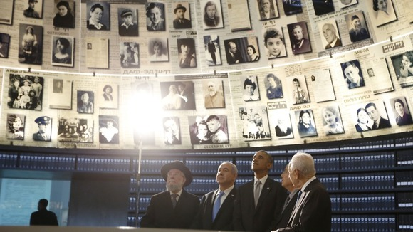 President Obama (C) tours the Hall of Names which commemorates millions of Jews murdered during the Holocaust