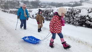 Family in the snow in Coedporth near Wrexham