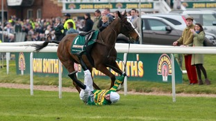 Tony McCoy falls from Synchronised before the John Smith's Grand National Steeple Chase