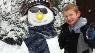 Ollie Brunskill with snowman