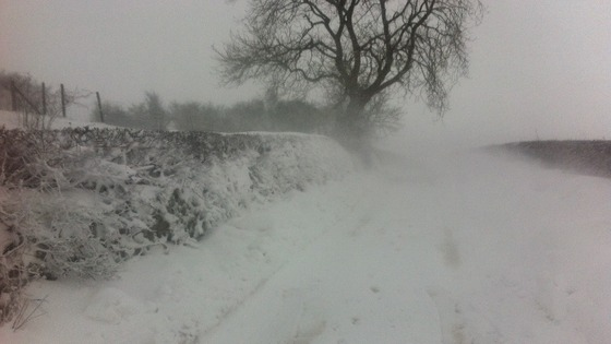 Rural road blocked by snow