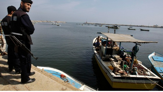 Members of Hamas&#x27; security forces stand guard at Gaza Seaport after the flotilla raid.