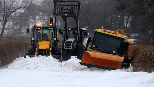 A digger clears snow from the road after a gritting vehicle got stuck in a ditch near Kippen in Stirlingshire.