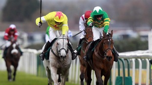 Neptune Collonges ridden by Daryl Jacobs (left) goes on to win during the John Smith's Grand National
