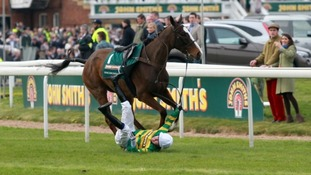 Tony McCoy falls from Synchronised before the John Smith's Grand National