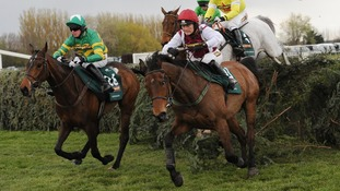Neptune Collonges ridden by Daryl Jacob (back right in yellow) clears the last fence before going on to win the John Smith's Grand National