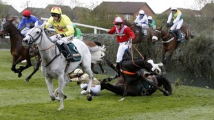 Neptune Collonges ridden by Daryl Jacob runs clear as According to Pete and Henry Haynes and On His Own and Paul Townshend fall at Bechers