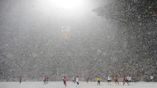 Snow falls during the 2014 World Cup qualifying football match