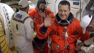 Space shuttle mission specialist Nicholas Patrick from England on board a space orbiter.