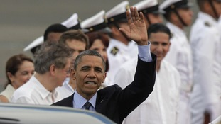 President Barack Obama waves upon arrival to Cartagena, Colombia, Friday April 13, 2012