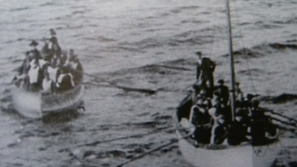 Harold Lowe pictured at the helm of a lifeboat
