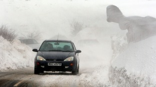 Motorists battle through blizzards and drifting snow in the hills above the Glens of Antrim, Northern Ireland.