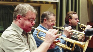 Derek Watkins (left) playing lead trumpet with the BBC Big Band at the Maida Vale Studios, London.