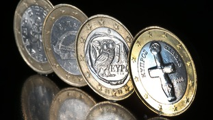 A Cypriot euro coin next to coins from fellow bailout countries Portugal, Ireland and Greece.