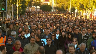 People march to the parliament during a protest in Nicosia today.