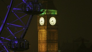 Elizabeth Tower, which houses Big Ben in London, illuminated prior to the light being turned off to mark WWF's Earth Hour 2013