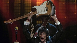 Ronnie Wood celebrates after the finale of the 2012 Rock and Roll Hall of Fame inductions.