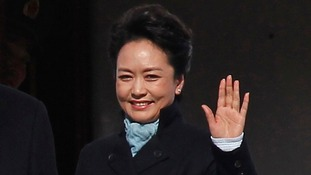 Chinese President Xi Jinping's wife Peng Liyuan greets crowds at Moscow's Vnukovo airport.