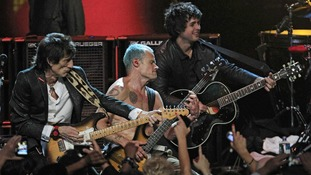 "Ronnie Wood, Mike ""Flea"" Balazary and Billy Joe Armstrong perform in the finale of the 2012 Rock and Roll Hall of Fame inductions."