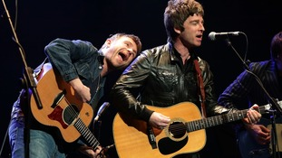 Damon Albarn and former musical foe Noel Gallagher perform together onstage for the Teenage Cancer Trust.