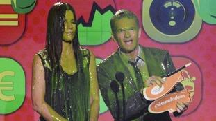 Sandra Bullock composes herself as fellow slime victim Neil Patrick Harris reveals the Favourite Movie Actress winner.