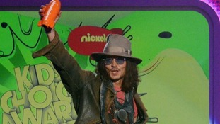 Kids' Choice regular Johnny Depp brandishes his award for Male Butt Kicker of the Year for his vampire film 'Dark Shadows'.