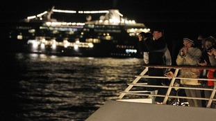 Passengers participate in a memorial service aboard the MS Balmoral.