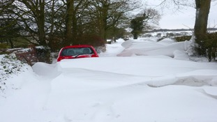 Cars stuck in drifting snow in Cheadle, Staffordshire.