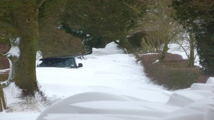 car stuck in snow drift