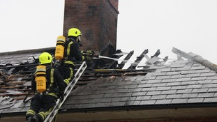 Firefighters tackle flames