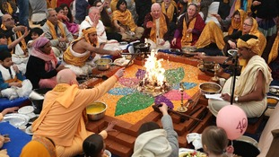 Members of the Hare Krishna congregation take part in a holy hindu ritual called Yajna.