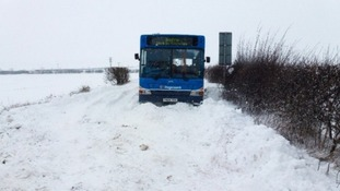 Bus stuck in snow on Mansfield Road near Palterton village, Derbyshire.