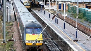 East Coast Main Line train pulls out of Peterborough Train Station