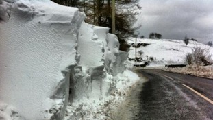 Snow has been cleared from a road in Northern Ireland.