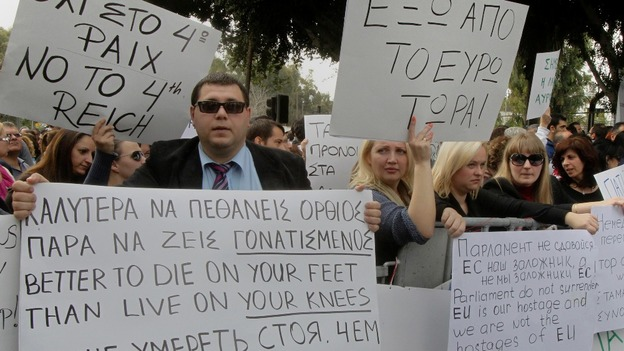 Protesters take part in an anti-bailout rally by employees of Cyprus Popular Bank in Nicosia on March 22.