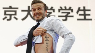 David Beckham shows off the tattoo at a news conference