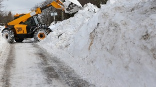 Workers begin clearing roads in Burnley