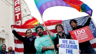 ame-sex marriage supporters take part in a march in support of gay marriage in San Francisco