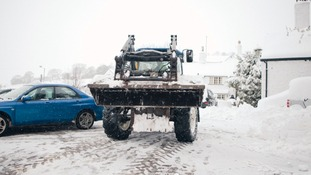 Snow plough clearing snow