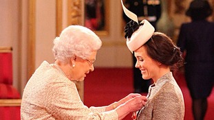 Cyclist Victoria Pendleton receiving her CBE from the Queen today.