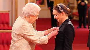 Designer Stella McCartney receiving her OBE from the Queen.