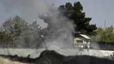 Smoke rises from a tower belonging to the British embassy after gunmen launched multiple attacks in Kabul.