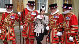Victoria Pendleton pictured with Beefeaters after receiving her CBE>