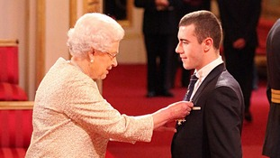 Paralympic gold medallist Josef Craig is handed his honour by the Queen.
