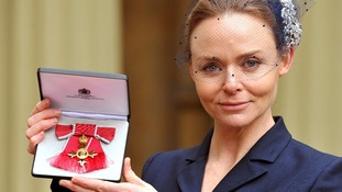 Stella McCartney shows off her OBE outside Buckingham Palace.