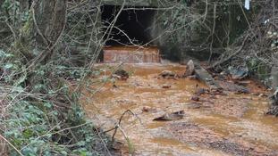 River Rhymney appearing orange