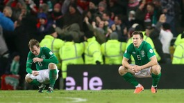 Republic of Ireland's Glenn Whelan and Sean St Ledger sit dejected after defeat to Austria